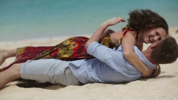 Thumbnail for Lovers Lying Down On The Beach