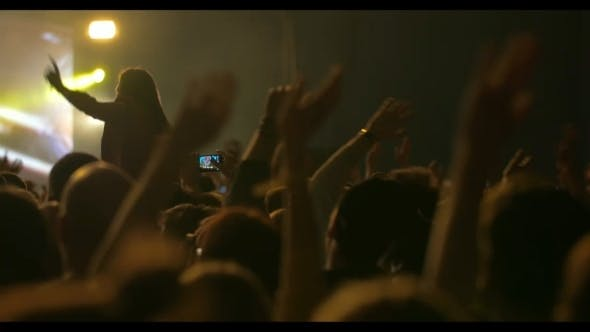 Thumbnail for Man Taking Photos Of The Concert On Smartphone