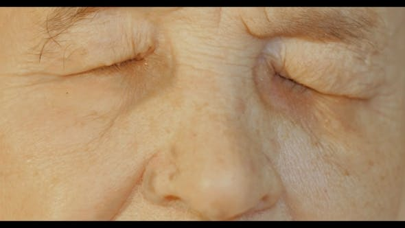 Thumbnail for Elderly Womans Face With Tired Expression