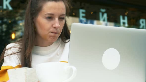 Thumbnail for Young Woman Use Laptop in Outdoor Cafe