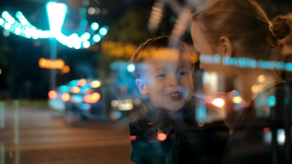 Happy Mother And Child Talking In Night City