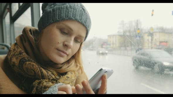 Thumbnail for Woman Texting On Cell Phone During Bus Ride In
