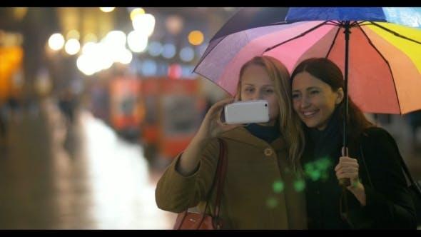Thumbnail for Female Friends Making Selfie Under Rainbow