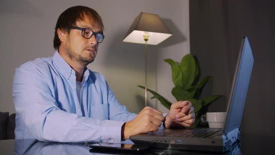 Cover Image for Man Freelancer Using Laptop Working From Home in Internet