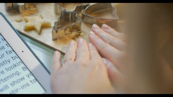 Thumbnail for Woman Making Cookies Using Recipe On Pad