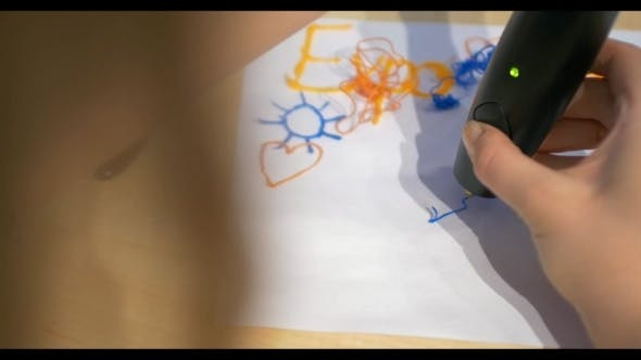 Thumbnail for Woman Drawing On Paper With 3D Pen