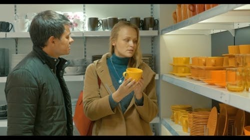 Couple In Utensil Shop