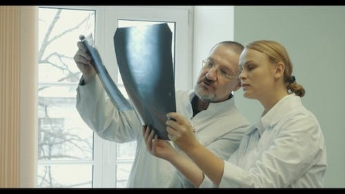 Two Doctors Comparing X-ray Images