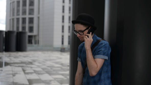 Thumbnail for Young Man Talking on Phone