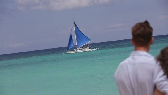 Thumbnail for Young Couple Looks At The Sailboat.