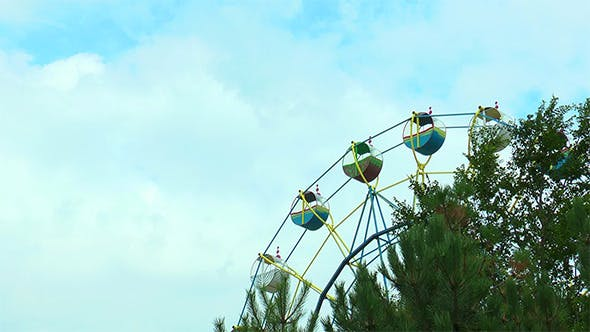 Thumbnail for Ferris Wheel on the Background Moving Clouds