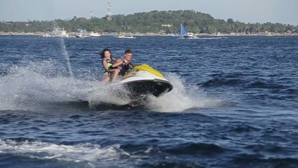 Thumbnail for Happy Couple Riding Jet Ski