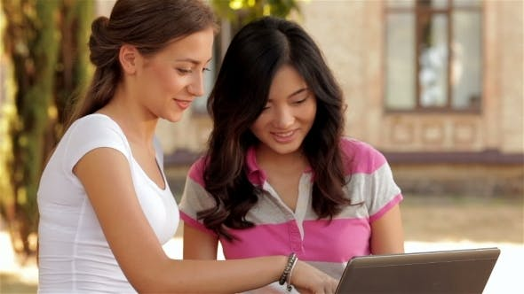 Thumbnail for Two Beautiful Girls Studying Outdoors