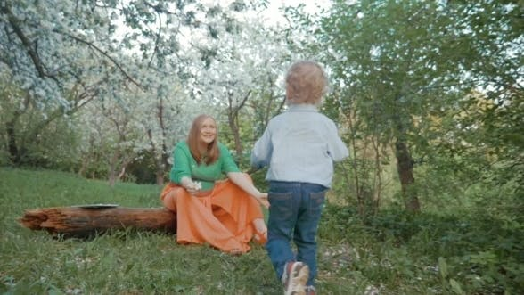 Thumbnail for Mother And Little Son Having Happy Time In Bloomy