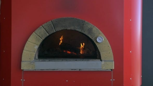 Thumbnail for Burning Firewood In Pizza Stove