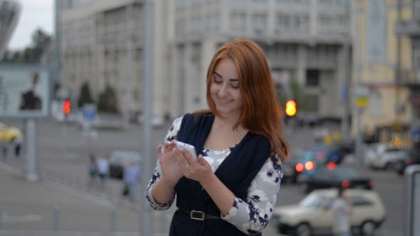 Thumbnail for Girl Using Smartphone on Street