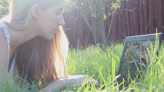 Thumbnail for Girl Typing on a Laptop in the Park