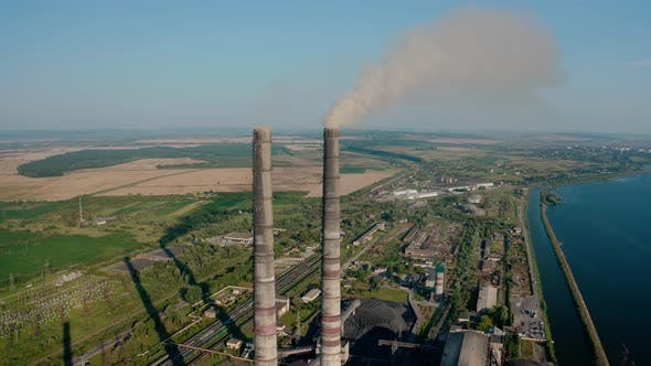 Thumbnail for Aerial Drone View of High Chimney Two Pipes with Grey Smoke From Coal Power Plant. Close Up V4