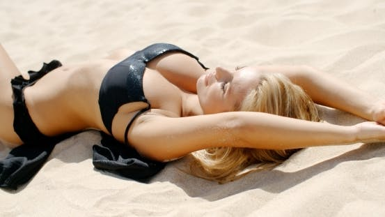 Thumbnail for Sexy Girl Lying On Sunny Sandy Beach
