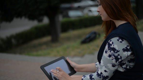 Thumbnail for Girl Using Tablet along Road