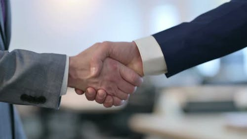 Close Up of Hand Shake Gesture By Two Businessmen