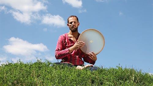 Young Man Playing The Tambourine
