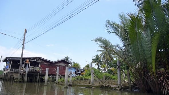 Traditional Fisherman Houses On Stilts. Poor Slum