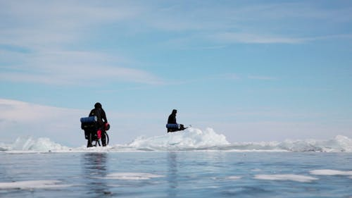 People Travel on Frozen Lake Baikal
