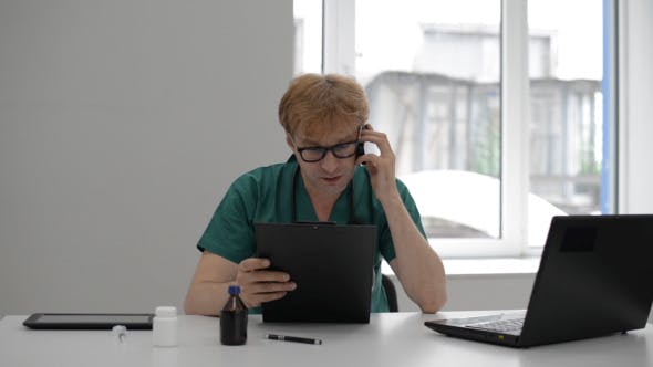 Thumbnail for Doctor Discussing Medical Report on Phone