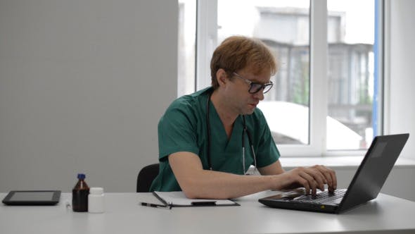 Thumbnail for Doctor Typing on Laptop