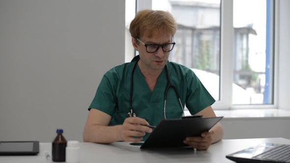 Thumbnail for Doctor Reading Medical Report