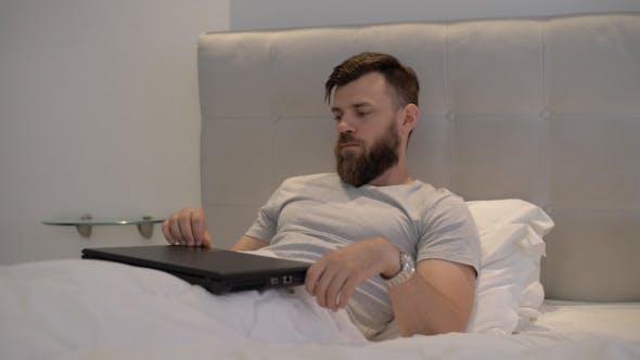 Thumbnail for Freelancer Finishes Using Laptop in Bedroom