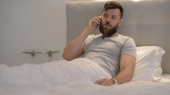 Thumbnail for Man Talking on Phone in Bed