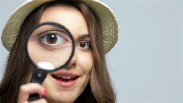 Thumbnail for Beautiful Girl With Loupe Zooming Her Eye