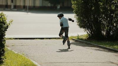 Little Boy Learning To Roller Skate
