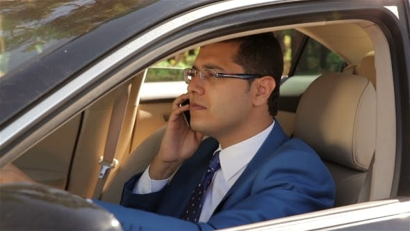 Cover Image for Businessman Talking On The Phone