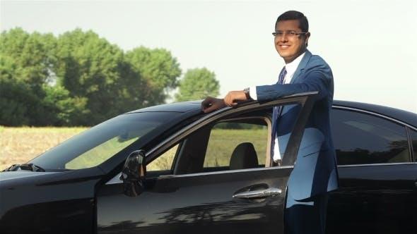 Thumbnail for Cheerful Businessman Waiting Next To His Car