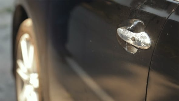 Cover Image for Mans Hand Opening Door Of a New Car