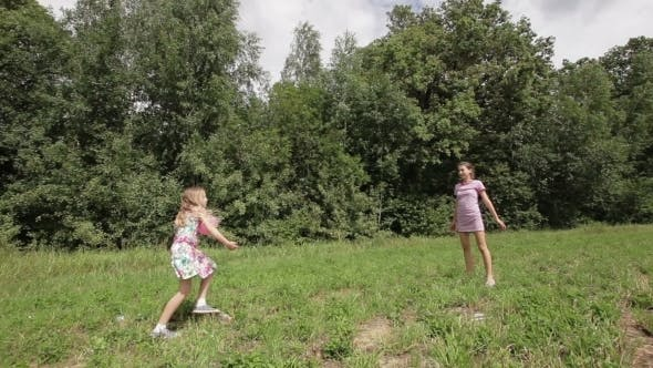 Thumbnail for Two Girls Playing With The Ball