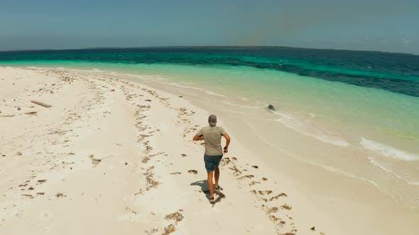 Thumbnail for Man Runs on a Sandy Beach on Vacation