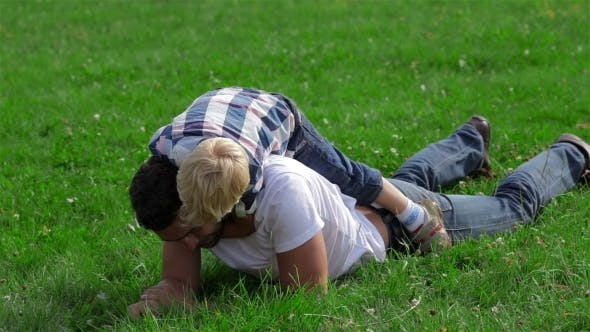 Cover Image for Father And Son Playing On The Grass In Park