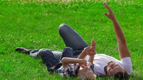 Thumbnail for Father And Son Dreaming On The Grass In Park