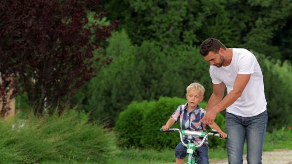 Thumbnail for Father Teaching His Son To Ride a Bike