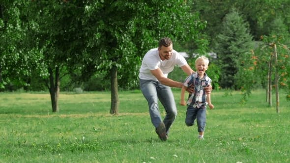 Thumbnail for Happy Father And Son Playing Outdoors