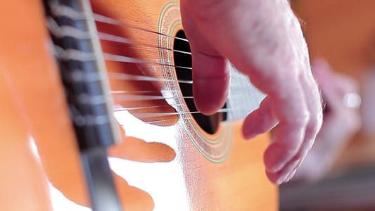 Thumbnail for Hand Playing A Guitar