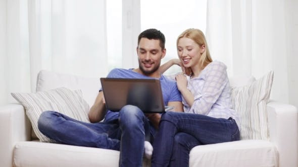 Thumbnail for Happy Couple With Laptop Computer At Home