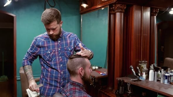 Thumbnail for Beard Barber Making Haircut To Hipster Client