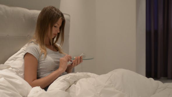 Thumbnail for Girl Using Smartphone in Bed at Night (2)