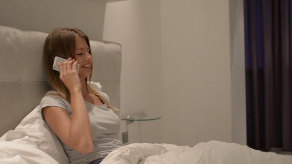 Thumbnail for Girl Talking on Phone in Bed