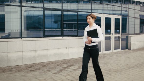 Thumbnail for Young Business Woman Walking On The Street